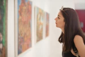 Young woman looking at modern painting in The Bainbridge Island Museum of Art