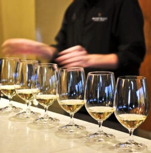 Wine tasting at Bainbridge Island winery. Row of white wine glasses in winery tasting event