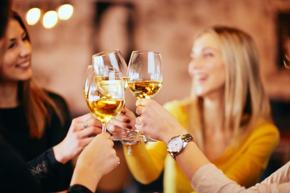 Friends enjoying some delicious bainbridge island wine tasting this summer